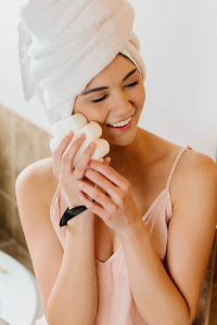 woman holding cleanse flower after taking a bath image for the waxing co